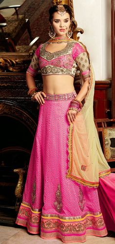 Mark your presence this season donning on this pink shade banarasi silk lehenga choli dress. The lace, patch, resham and stones work seems chic and perfect for any function. Banarasi Lehenga, Pink Lehenga, Lehenga Saree, Bridal Lehenga, Wedding Chaniya Choli, Ghagra Choli, Silk Sarees Online Shopping, Choli Dress, Mode Simple