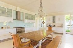 A huge wood communal table? Drool. | 12 Gorgeous Kitchens That Will Make You Want To Redecorate