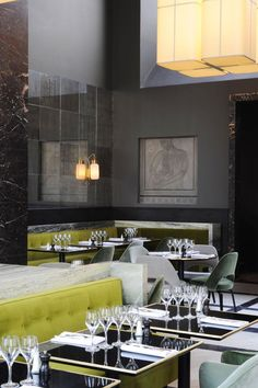 Bright green velvet and dark green marble banquette seating at Monsieur Bleu by Joseph Dirand, Remodelista
