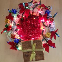 Wreath of presents, bows, lights, and bells, by Donato Jara