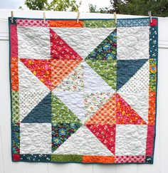 There's nothing quite as simple and traditional as a good old-fashioned star quilt block, and now you can put a modern twist on it with this Lone Star Baby Quilt Pattern.