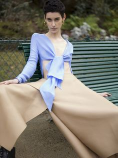 Laser cut silk trousers with blue bow top