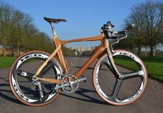 """David Lightbourne. David designed and built the wooden frame, and has used it """"regul arly for training, time trials and triathlons with some pleasing results."""" It's a great looking bike, and I am sure that it garners quite a bit of (well deserved) attention at the races."""