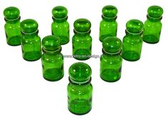 Set of 10 apothecary jars, green Apothecary jars 10 pieces. Vintage apothecary jars in green colored glas with plastic sealing ring. From the 70s and still in an excellent vintage condition. Height: 9 cm. Diameter: 4,5 cm. see: http://www.retro-en-design.co.uk/a-44049595/glass/set-of-10-apothecary-jars-green/