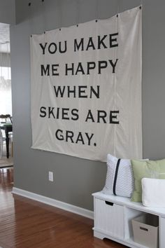 """Tips from http://www.housetweaking.com/ """"Take a phrase from a favorite song, book or movie and turn it into art. Use a projector to transfer the font onto a wall or fabric for large scale wall art."""""""