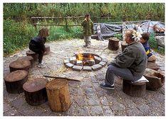 Use of stumps as backyard seating/climbing.