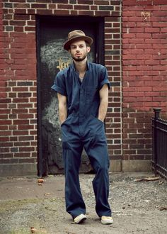 2 Ways to Wear a Jumpsuit- The second way is formal/Brooklyn businessman. Pop the collar, turn down the hems, shed that bandana, and top it all off with a vintage fedora. This is a great look for when you're not necessarily working on cars.