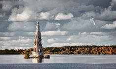 Kalyazin Bell Tower, Russia. [The belfry of famous church, 2/3 submerged underwater in Volga pond in period of 1930s.]