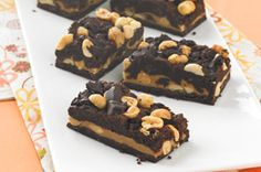 Chocolate-Peanut Butter Cookie Bars recipe-With flavor just like Grandma's chocolate-peanut butter cookies, these cookie bars start with a cake mix, making prep a breeze. #GameDay