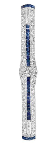 Art Deco Platinum, Diamond and Sapphire Bar Pin   One old-mine cut diamond ap. .45 ct., 72 old European & single-cut diamonds ap. 1.90 cts., 30 French-cut sapphires ap. 1.95 cts., c. 1920, ap. 7.3 dwt.
