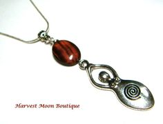 """This pendant was handcrafted by me. I used a silver plated Goddess charm and added a red tiger eye bead. The pendant hangs 2.75"""" and comes on your choice of chain. You will get to choose from silver plated snake chain or antique silver plated link chain. This necklace ships free within the US via First Class Mail through USPS."""
