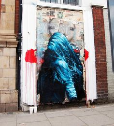 snik's signature vibrant paste-ups feature in Notting Hill, London.(via street art curator)