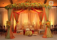 Our Crisp Harvest Mandap With Chandelier Hanging From The Dd Canopy And Fresh Green Fl Accented By Bright Oranges Yellows