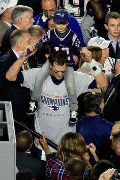 Tom Brady celebrates the moment with his son Benjamin.