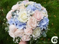 Hand tied bouquet of roses, hydrangea and gypsophila