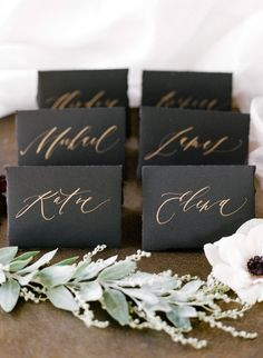 Festive Fashion-Forward Winter Wedding Inspiration : Elegant black and gold place cards This Festive Fashion-Forward Winter Wedding Inspiration from Rebecca Yale features two gorgeous brides and Claire Pettibone rings for Trumpet And Horn. Wedding Places, Wedding Day, Wedding Dress, Diy Wedding, Nautical Wedding, Wedding Favors, Wedding Flowers, Wedding Place Names, Wedding Gold