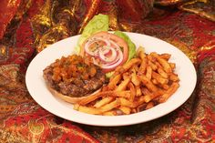 A delicous twist on an original beef burger!  A delightful mix of beef and lamb make a juicy combination topped with onion & raisin chutney, tomatoes & lettuce!  http://www.thesultanstent.com