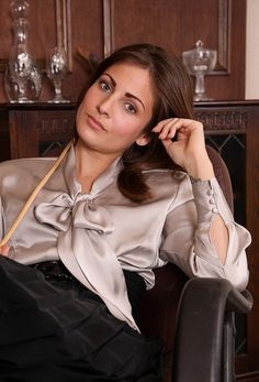 CHRISTIAN GOVERNESS RELAXING AFTER GIVING A NAUGHTY BOY A VERY SEVERE CANING
