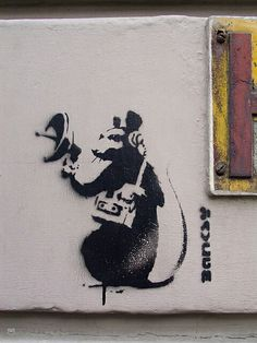 Spy Rat, Banksy Banksy is a pseudonymous England-based graffiti artist, political activist, film director, and painter. His satirical street art and subversive epigrams combine dark humour with graffiti done in a distinctive stencilling technique.
