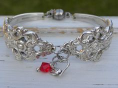Spoon handle bracelet  heart charm  red by WhisperingMetalworks