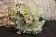 A Beautiful all white bridal bouquet designed by Eastern Floral.