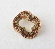 Vintage Amber Rhinestone Brooch: Golden Brown Topaz Rhinestones, Citrine Yellow Crystals, Gold Brooch, Rope Trim, Scalloped Circle Pin by ninthstreetvintage on Etsy