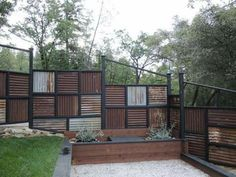 Fence made using old corrugated metal roofing. Fence made using old corrugated metal roofing. Corigated Metal, Metal Roof, Black Metal, Metal Art, Diy Fence, Backyard Fences, Fence Ideas, Garden Fencing, Decking Ideas