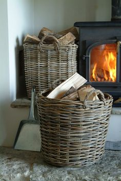 Love the wicker baskets to store the fire wood