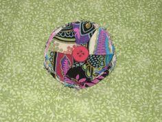 vibrant colored fabric button flower clip