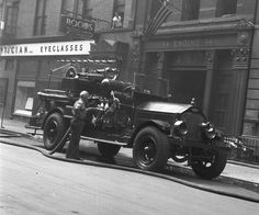 ◆A firefighter is shown here attending to a 1927 FDNY engine from Engine 54. The photo was taken in the late 1940's◆