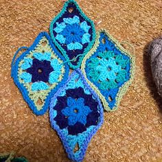 """I am not a fan of granny squares usually but I saw a picture of Jane Crowfoots pattern for Chinese Lantern shaped granny """"squares"""" and decided to create my own. I named this pattern after my son Tom who has always made me proud to be his mom."""