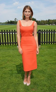 Gemma Arterton in a flattering orange Jasper Conran dress.