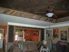Barn wood wainscot done with tin added to wall, barn wood and tin to tray ceiling - all done by Barn Wood Furniture