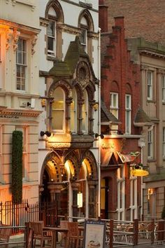 Street in Nottingham, England shows decorative Victorian row houses.
