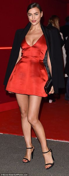 Sweet: Irina carried a cute little clutch bag in her hand as she made her way inside the venue