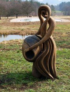 Aquarius wood statue