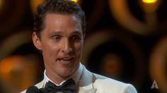 """Jennifer Lawrence presenting Matthew McConaughey with the Oscar® for Best Actor for his performance in """"Dallas Buyers Club"""" at the 86th Oscars® in 2014. Matthew McConaughey winning Best Actor"""