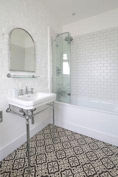 Bathroom flooring bathroom mediterranean with metro tile white painted brick wall