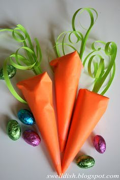 Paper Carrots with chocolate eggs inside - could be anything but how cute from the Easter Bunny!
