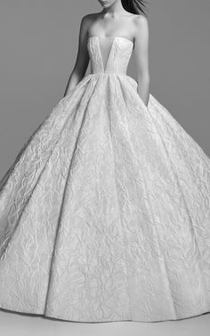 """This Alex Perry Bridal Blake Strapless Floral Gown""""featuresa textured ball gown silhouette with a straight neckline, deep v illusion mesh and pleated skirt."""