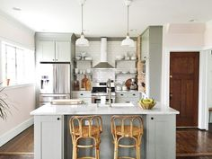 Gorgeous kitchen renovation! Those cabinets are IKEA and the whole space is just beautiful.