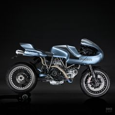 One of the most spectacular Ducati customs we've ever featured on these pages, is now up for sale. It belongs to our good friend and Oil in the Blood filmmaker, Gareth Roberts, and it has a build sheet that'll make your eyes and mouth water. Ducati Motorcycles, Custom Motorcycles, Custom Bikes, Scrambler Custom, Ducati Cafe Racer, Cafe Racer Bikes, Cafe Racers, Ducati 749, Ducati Scrambler