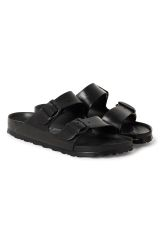 <p>The Arizona Eva Sandal by Birkenstock is a pair of solid black, two-strap sandals made of plastic with fully adjustable straps. The footbed has pronounced arch support, deep heel cup, and roomy toe box. The footbed molds and shapes to your foot. </p>