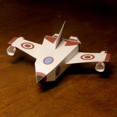 Very simple papercraft for kids from 5 years up: Build your very own customizable spaceship. Free printable and blank template for coloring.