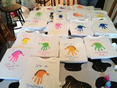 Dinosaur theme t-shirts. I used acrylic paint for the handprint and puff paint for everything else!