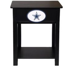 """Fan Creations Dallas Cowboys Logo Night Stand/Side Table by Fan Creations. $89.99. Constructed with MDF and birch woodBlack finish. Features NFL® team logo. Side table. Dimensions: L 14.75"""" x W 19.75"""" x H 24"""" Officially licensed. Add some football flair to your home décor with the Fan Creations® Logo night stand/side table! Your favorite NFL® team logo is displayed within a decorative ring on the front. It's painted with a modern black finish.. Save 28%!"""