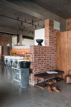 """""""He wanted a penthouse with exposed concrete walls, floors, ceiling, and red brick cladding reflecting an open industrial design"""". And that's exactly what The Crossboundaries gave the family. Interior Design Blogs, Brick Interior, Interior Design Living Room, Interior Livingroom, Interior Doors, Exposed Concrete, Concrete Walls, Concrete Floor, Tile Floor"""