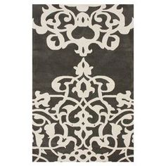 Hand-tufted wool rug in pewter with a damask motif. Made in India.   Product: RugConstruction Material: 100% WoolColor: PewterFeatures:  Hand-tuftedMade in India Dimensions: 6' x 9'Note: Please be aware that actual colors may vary from those shown on your screen. Accent rugs may also not show the entire pattern that the corresponding area rugs have.