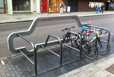 a perm or temp bike rack with a pump built in for free air, it takes up one parking spot to make room for 10 bikes!