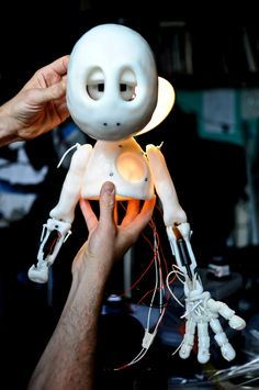 A puppet with robotic features and emotional expressions helped the public think about the role of machines in everyday life. Photo by Ben Dowden. World Problems, Life Photo, Research, Puppets, Robot, Disney Characters, Fictional Characters, Public, Search